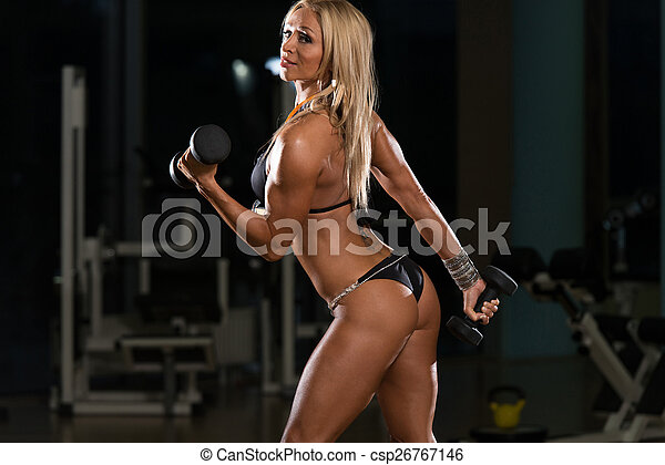 Hot Woman Doing Exercise For Biceps