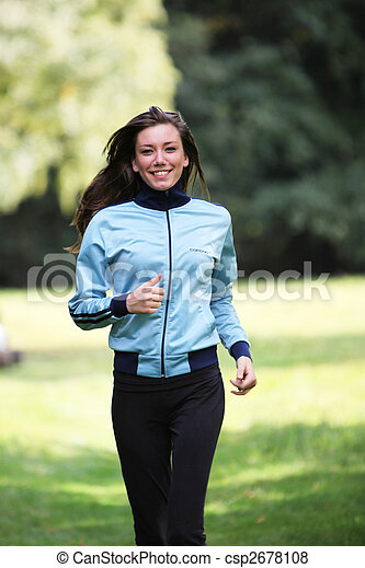 smiling young woman in sports - csp2678108