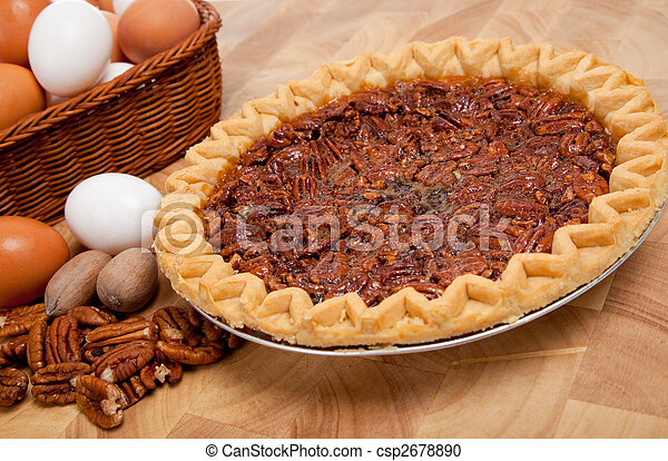 Pecan pie with ingredients on a cutting board - csp2678890