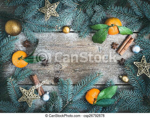 Christmas (New Year) decorations: fur-tree branches, golden glas