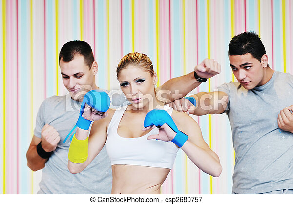 young adults group in fitness club - csp2680757