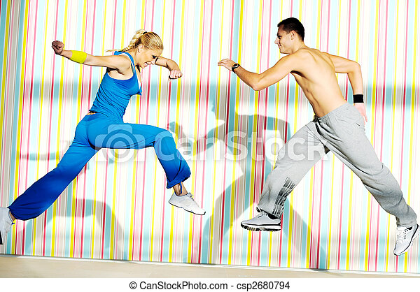 young adults group in fitness club - csp2680794