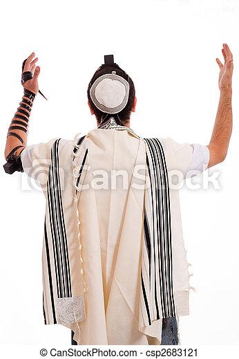 Rear view of jewish men put phylactery - csp2683121