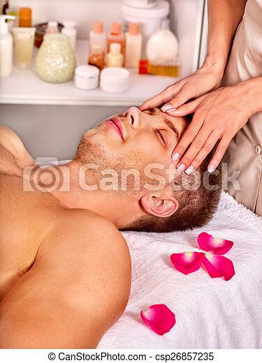 Man getting  facial massage . - csp26857235