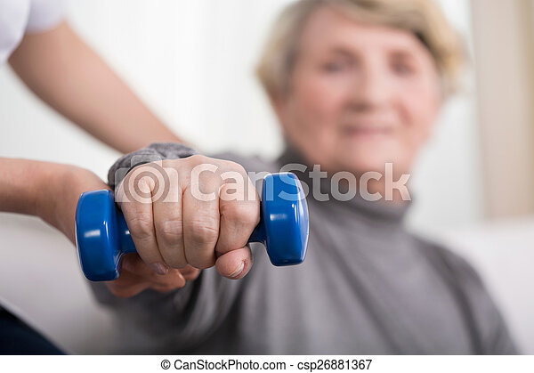 Elder woman training with physiotherapist - csp26881367