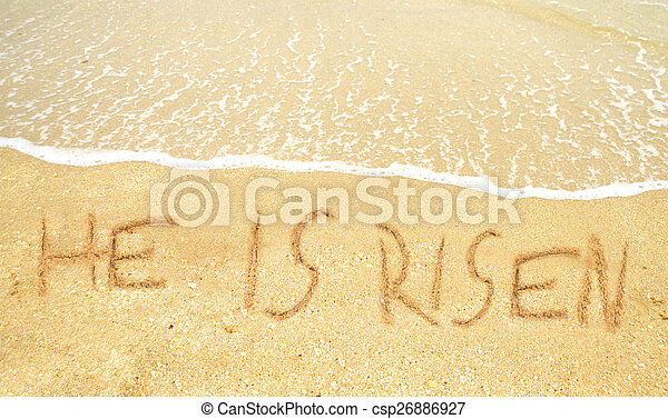 He is risen written in the sand for easter