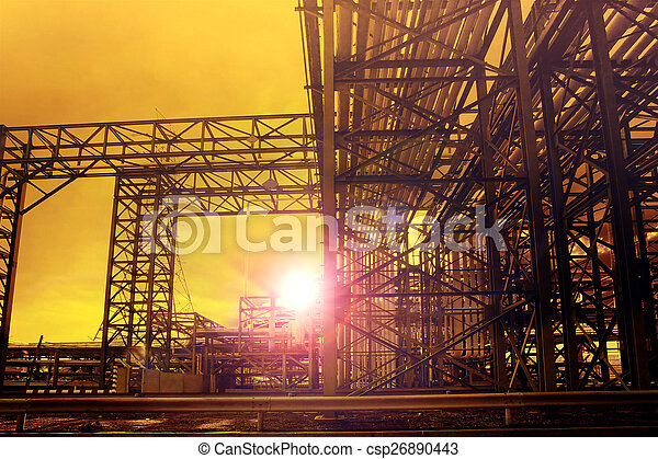 metal structure of industry chemical tube in heavy industrial estate against beautiful sun rising with lens flare effect use for industry background