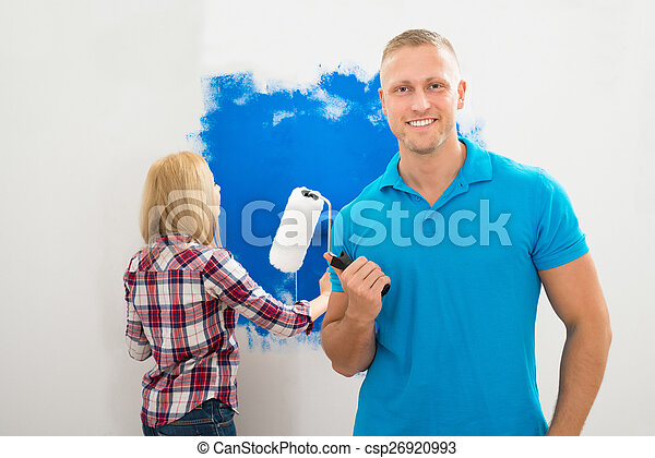 Young Man Holding Paint Roller
