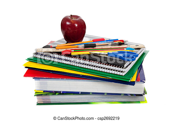stack of textbooks with school supplies on top - csp2692219