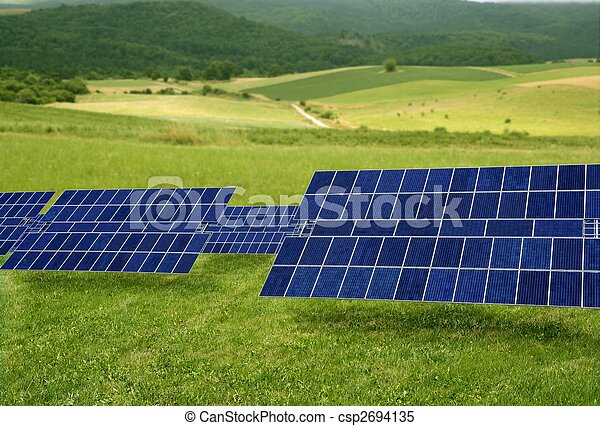 Clean electric energy solar plates in meadow - csp2694135