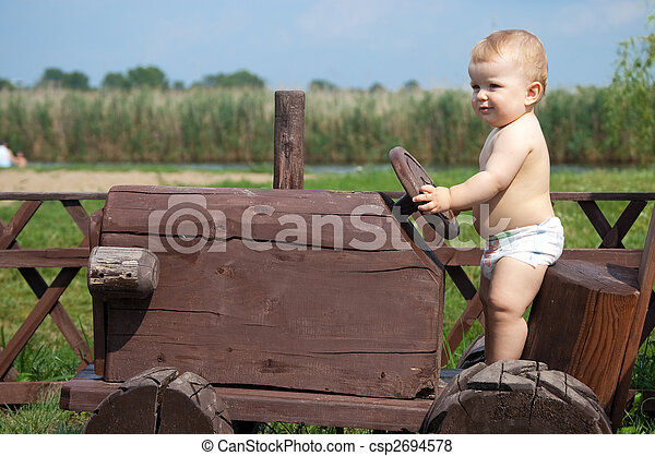boy on a tractor - csp2694578