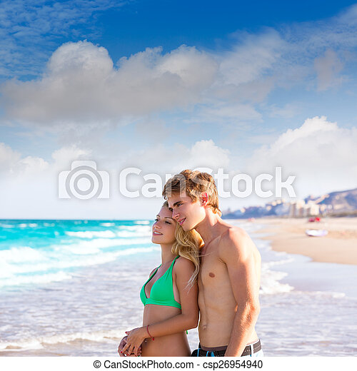 Blond couple of young tourists in a tropical beach