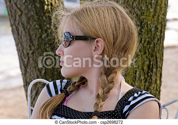 Candid Pose - csp2698272. Young teen with braids in sunglasses. Save Comp