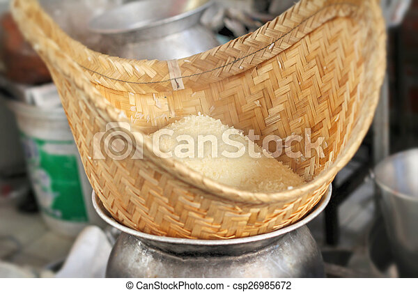 making steamed sticky rice in pot