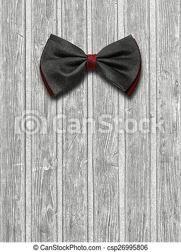 Black and red bow tie on a light wooden background
