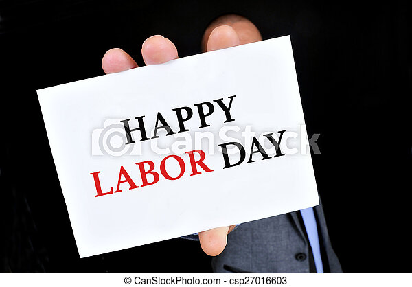 man showing a signboard with the text happy labor day
