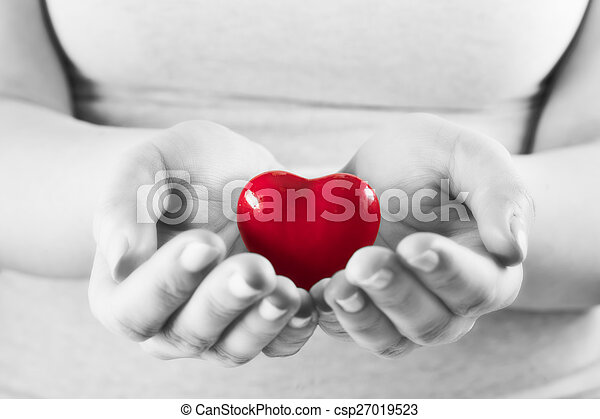 Heart in woman hands. Love giving, care, health, protection. - csp27019523
