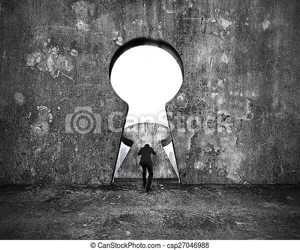 Businessman pushing keyhole door with city buildings view