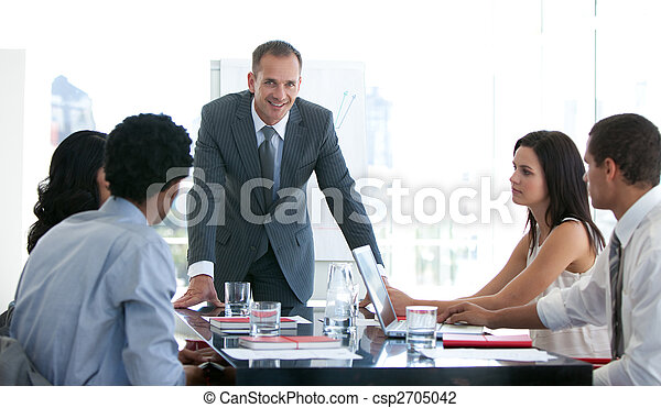 Business people studying a new plan in a meeting - csp2705042
