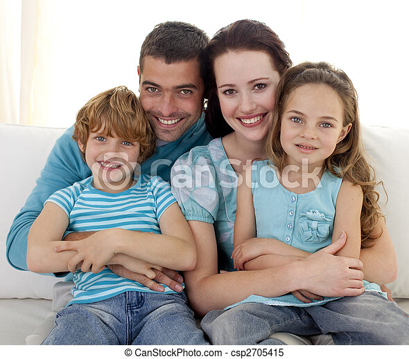 Family sitting on sofa together - csp2705415