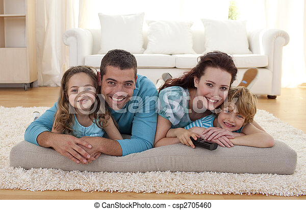 Smiling family on floor in living-room - csp2705460