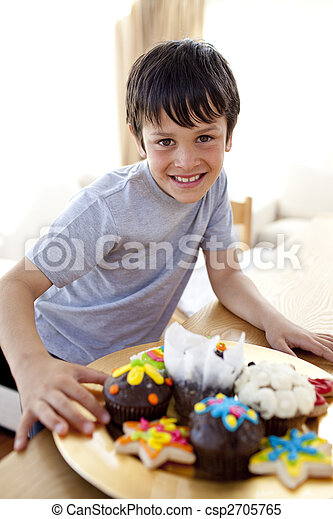 Happy boy eating colorful confectionery - csp2705765