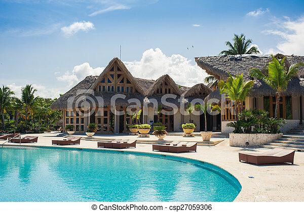 Outdoor Swimming pool of luxury hotel resort near the sea. Tropical Paradise. spa resort. Dominican Republic, Seychelles, Caribbean, Bahamas.