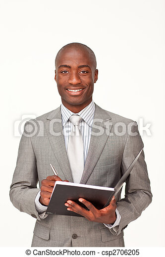 Afro-american businessman writing notes - csp2706205