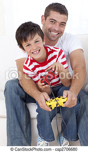 Father and son playing video games at home - csp2706680
