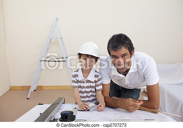 Smiling dad and little boy studying architecture - csp2707273