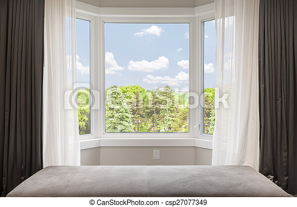 Bay window with summer view - csp27077349
