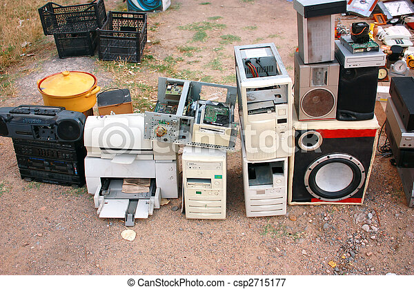Old computer parts and electronic junk in flea market - csp2715177
