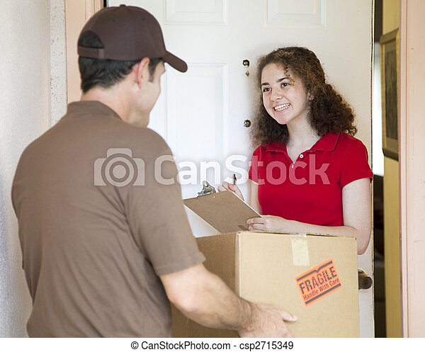 Young Woman Signs for Delivery - csp2715349