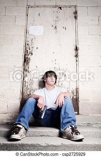 teenager with handgun - csp2725929
