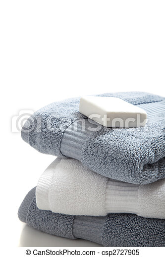 White and blue towels with soap on white - csp2727905