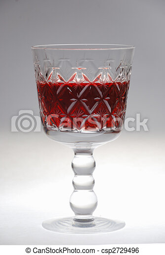footed tumbler of red wine over white - csp2729496