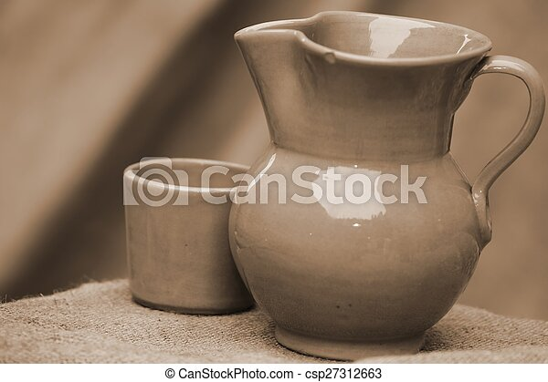 antique ceramic jug with medieval-style glass - csp27312663