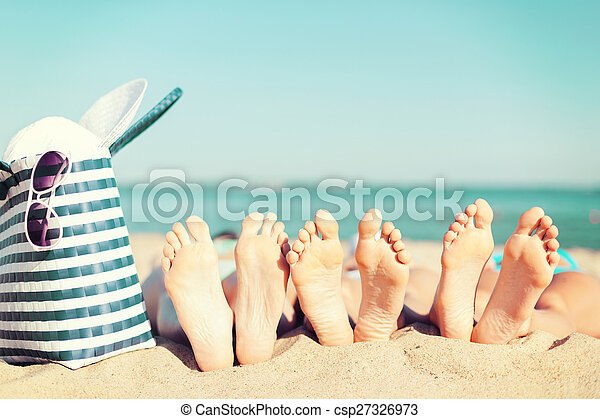 three women lying on the beach