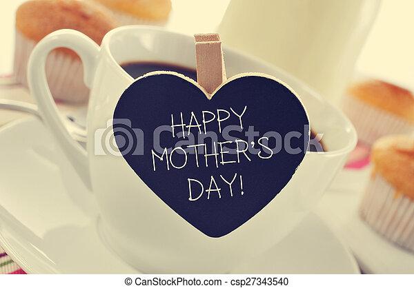 breakfast and happy mothers day written in a heart-shaped blackboard