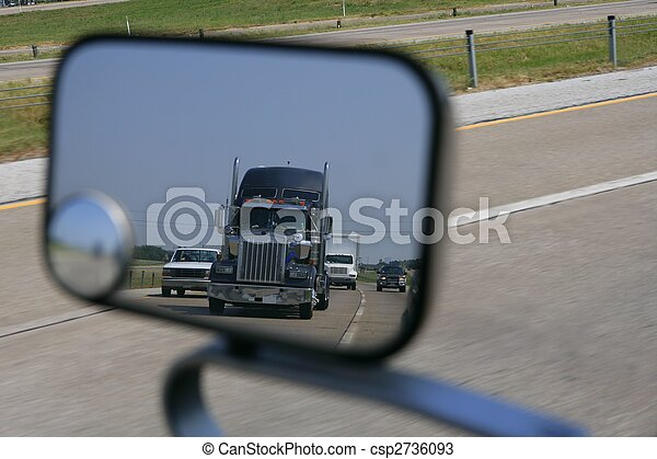 Truck coming rear view from the road miror - csp2736093