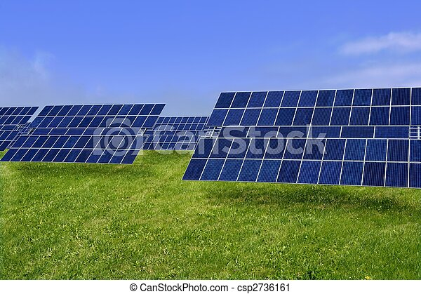 Clean electric energy solar plates in meadow - csp2736161