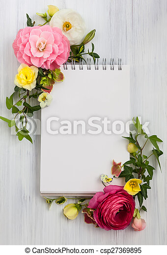 Flowers and notepad