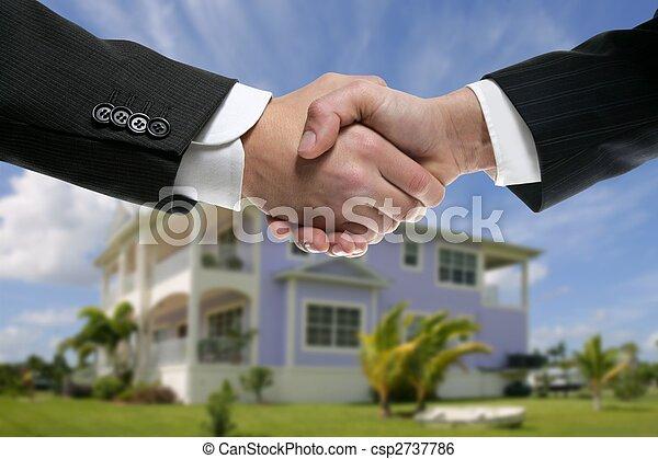 Businessman real state handshake partners - csp2737786