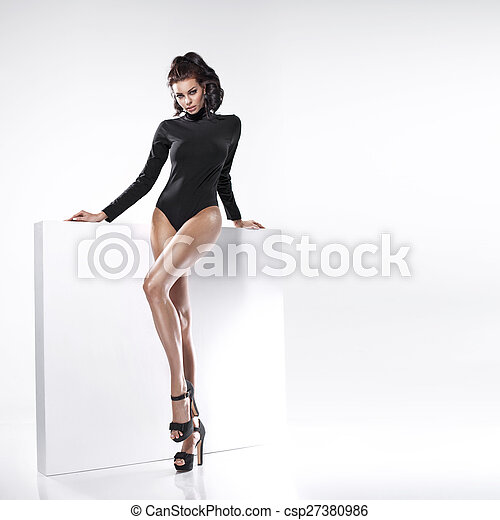 Young beautiful lady with long legs