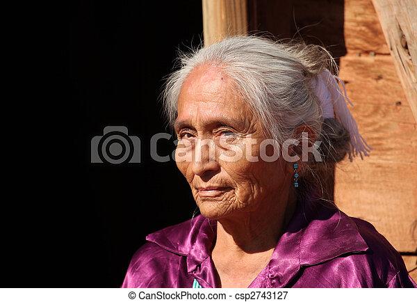 Beautiful Navajo Elderly Woman Outdoors in Bright Sun - csp2743127