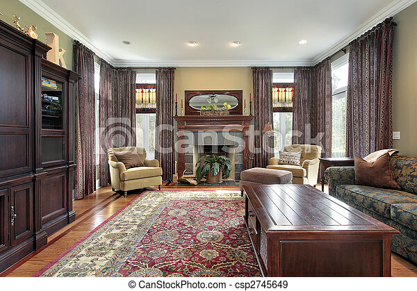 Living room with slate fireplace - csp2745649