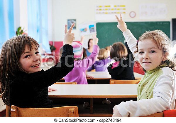 happy teacher in  school classroom  - csp2748494