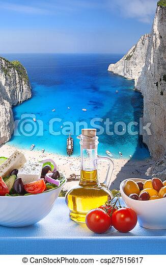 Navagio beach with Greek salad in Zakynthos, Greece - csp27515617