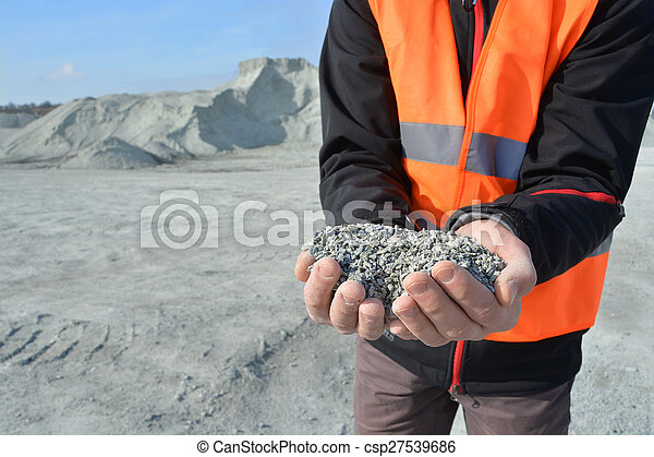 Worker holding pebbles in hands