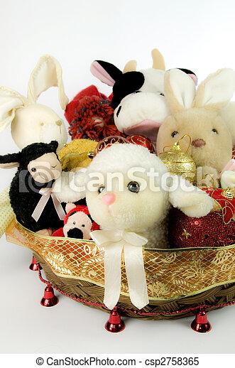 Toys stuffed into Christmas baskets